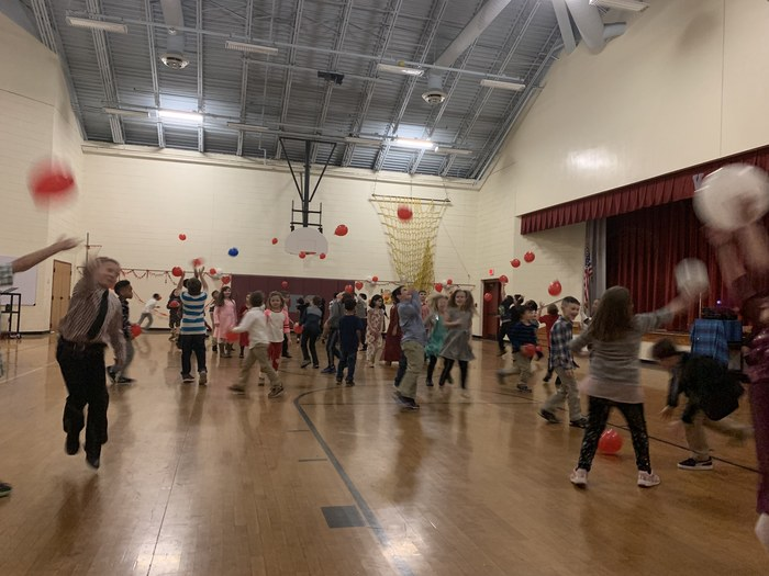 Student's have fun with balloons at the Valentine's Dance