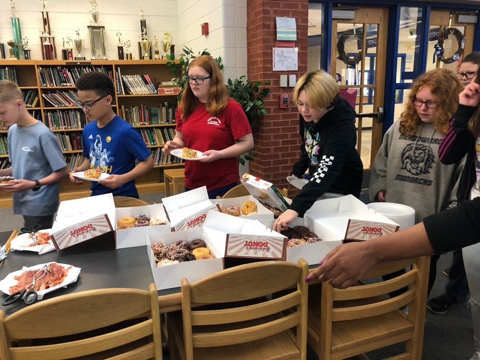 Classes enjoying donuts